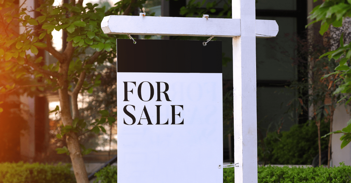 For sale sign in front of a home that was listed by a real estate agent.