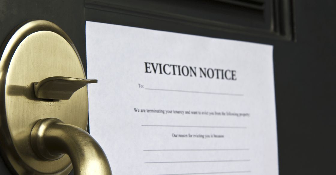 An eviction notice posted on the door of a residential property.